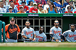 20 May 2012: Baltimore Orioles Manager Buck Showalter (left) watches game action against the Washington Nationals from the dugout along with Robert Andino (11), Bill Hall (35), Nick Markakis (21), and Adam Jones (10) at Nationals Park in Washington, DC. The Nationals defeated the Orioles 9-3 to salvage the third game of their 3-game series. Mandatory Credit: Ed Wolfstein Photo