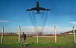 A farmer passes Lajes Field runway as a KC-110 takes off on a mission from Terceira, Azores. Far out in the Atlantic Ocean, some 850 miles off the western coast of Lisbon, Portugal lies the 425-mile long archipelago of the Azores. (Jim Bryant Photo).....