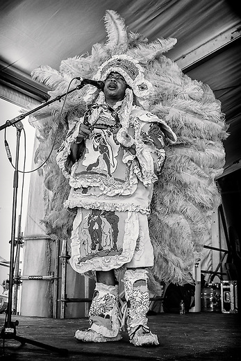 Irvin 'Honey' Bannister of the Creole Wild West Mardi Gras Indians performs on the Jazz and Heritage Stage during the 2013 New Orleans Jazz & Heritage Music Festival at Fair Grounds Race Course on May 4, 2013 in New Orleans, Louisiana. USA.