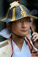 Member of a parade during the Somanomaoi Festival, Minami-soma City, Fukushima Prefecture, Japan, July 27, 2013. During the four-day-long Somanomaoi Festival members of old samurai families ride horseback through the town in traditional armour.  They also take conduct ceremonies at local shrines, take part in horse races, and compete on horseback to catch a flag launched into the air by fireworks.