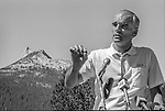 "Tuolumne Meadows, August 24, 1985:  Secretary of the Interior Don Hodel speaks to crowd with Cathedral Peak in background.  Mount Ansel Adams, an 11,700 foot peak in a remote section of Yosemite National Park was dedicated Saturday, August 24, 1985, in a ceremony recognizing the famed photographer for his contribution to the American conservation movement. Adams was eulogized as a man who dedicated his life to photography and the preservation of planet Earth. The dedication ceremony was led by Adams' son, Dr. Michael Adams of Fresno, and attended by Adams' widow, Virginia Adams, Secretary of the Interior Donald Hodel, Sen. Alan Cranston, D-California, National Park Service Director William Penn Mott, actor Robert Redford, and other environmental and conservation leaders. In 1932, Ansel Adams and several Sierra Club companions first climbed the peak, according to Virginia Adams, who added that ""Ansel loved its tower shape. He called it 'The Tower' on the Lyell Fork of the Merced River. After they came down from climbing it, they sat around the campfire and one of them suggested that they name it Mount Ansel Adams."" Informally, that is what the Sierra Club did, calling the peak Mount Ansel Adams in the Sierra Club Guide until 53 years later the peak was finally officially named.  Photo by Al Golub/Golub Photography"