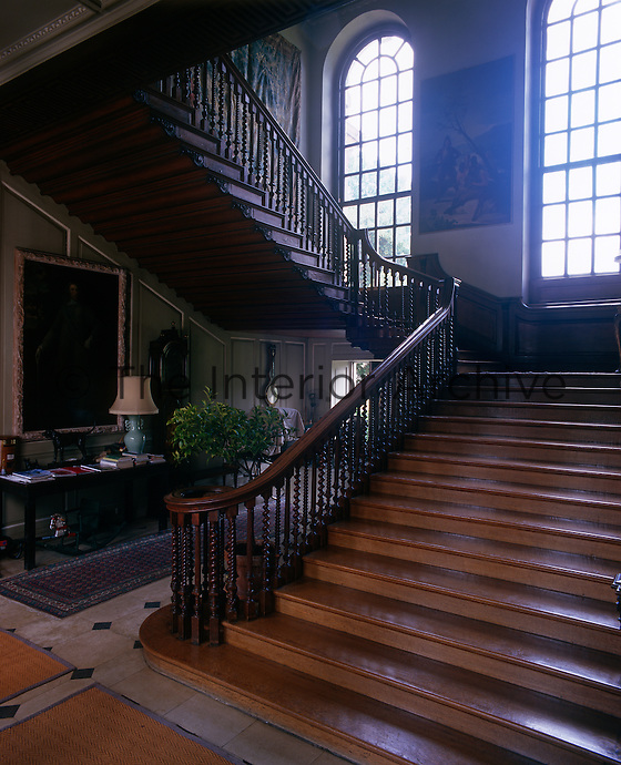 The magnificent early 18th century staircase is made of oak inlaid with walnut