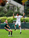 13 September 2009: University of Massachusetts Minutemen midfielder Bryant Craft, a Sophomore from Worcester, MA, jumps high against the University of Vermont Catamounts, during the second round of the 2009 Morgan Stanley Smith Barney Soccer Classic held at Centennial Field in Burlington, Vermont. The Catamounts and Minutemen battled to a 1-1 double-overtime tie. Mandatory Photo Credit: Ed Wolfstein Photo