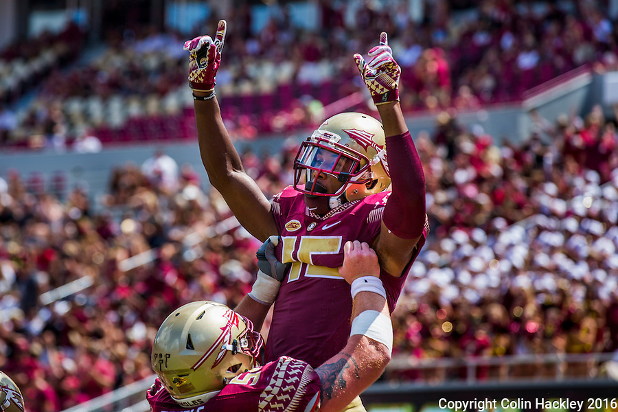 TALLAHASSEE, FLA 9/10/16-Florida State's Travis Rudolph is lifted by Alec Eberle as they celebrate Rudolph scoring the Seminole's third touchdown against Charleston Southern's during first quarter action Saturday at Doak Campbell Stadium in Tallahassee. <br /> COLIN HACKLEY PHOTO