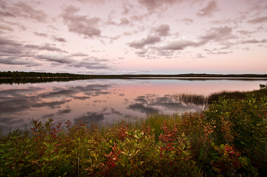 AuTrain Lake with fall color at dusk near AuTrain Michigan on the Upper Peninsula.