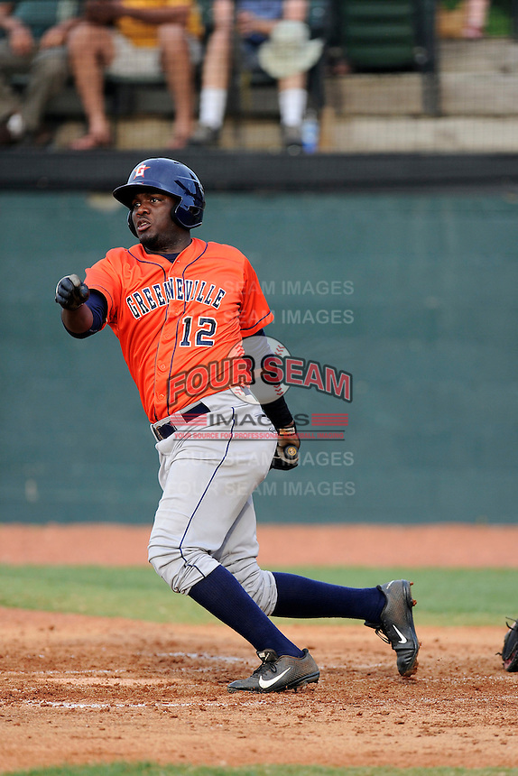 Right fielder Ydarqui Marte (12) of the Greeneville Astros bats in a game against the Bristol Pirates on Saturday, July 26, 2014, at DeVault Memorial Stadium in Bristol, Virginia. Greeneville won, 2-1 in Game 1 of a doubleheader. (Tom Priddy/Four Seam Images)