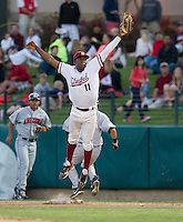 STANFORD, CA - April 19, 2013: Stanford first baseman Brian Ragira (11) makes a leaping catch during the Stanford vs Arizona baseball game at Sunken Diamond in Stanford, California. Final score, Stanford 4, Arizona 3.