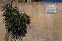 Isola di Pianosa. Pianosa Island. .Le targhe stradali dedicate ai morti ammazzati dalla mafia..The street signs dedicated to the dead killed by the Mafia.Piazzetta Libero Grassi..