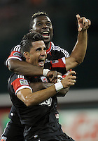 WASHINGTON, DC - OCTOBER 20, 2012:  Marcelo Saragosa (11) of D.C United celebrates with Brandon McDonald (4) after scoring the second goal against the Columbus Crew during an MLS match at RFK Stadium in Washington D.C. on October 20. D.C United won 3-2.