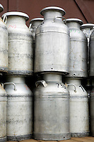 Commercial Milk Cans stacked