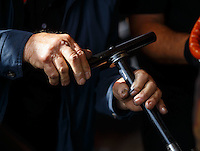 May 15, 2016; Commerce, GA, USA; Detailed view of the hands of NHRA top fuel driver Chris Karamesines as he works on his dragsters engine in the pits during the Southern Nationals at Atlanta Dragway. Mandatory Credit: Mark J. Rebilas-USA TODAY Sports