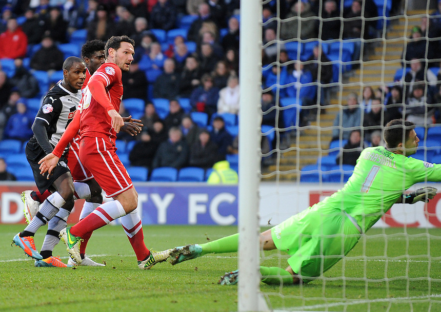Watford's Odion Ighalo scores his sides second goal <br /> <br /> Photographer Ian Cook/CameraSport<br /> <br /> Football - The Football League Sky Bet Championship - Cardiff City v Watford - Saturday 28th December - Cardiff City Stadium - Cardiff<br /> <br /> &copy; CameraSport - 43 Linden Ave. Countesthorpe. Leicester. England. LE8 5PG - Tel: +44 (0) 116 277 4147 - admin@camerasport.com - www.camerasport.com