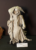 New York, NY, USA - June 22, 2012: A display at the OrigamiUSA 2012 convention exhibition held at Fashion Institute of Technology in New York City. This complex model, folded from one square of paper, of the Grim Reaper was designed and created by Japanese artist Myamoto Chuya.