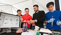 "(L-R) Seung Shin, Jason Candreva, Vandan Shah and Edward Chau explain their peptide probe for the detection of beta-amyloid oligomers, research meant for the early detection of Parkinson's Disease at the  NYU-Polytechnic School of Engineering's second annual Research Expo in Brooklyn's ""Tech Triangle"" in New York on Friday, May 2, 2014. Over forty research projects and their creators will exhibit and explain their research including cutting-edge robotics, engineering and biotechnology.  (© Richard B. Levine)"