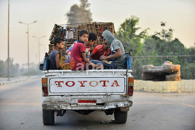 Egyptians villagers ride a truck at Birqash outside of Cairo, Egypt, Sept. 30, 2015. Photo by Amr Sayed