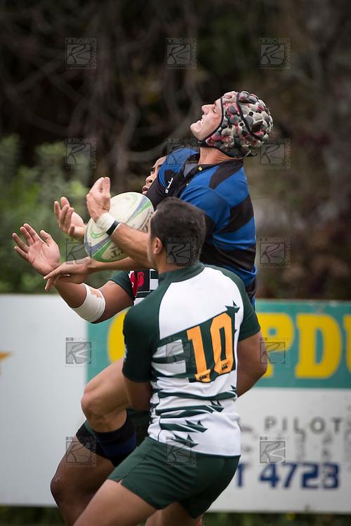 David Bason catches the high ball between Taesim Faimasasa and John Moimoi. Counties Manukau Premier Club Rugby game between Onewhero and Manurewa, played at Onewhero on Saturday 20th of April 2013. Onewhero won the game 30 - 20 after leading 13 - 7 at halftime.