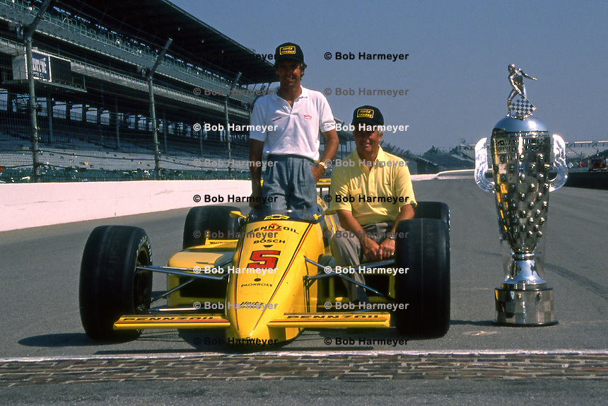 INDIANAPOLIS, IN - MAY 29: Rick Mears and Roger Penske pose with the Penske PC17 004/Chevrolet and the Borg Warner trophy on the front straight of the Indianapolis Motor Speedway after winning the Indianapolis 500 USAC Indy Car race in Indianapolis, Indiana, on May 29, 1988.