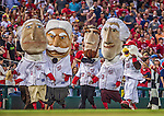 20 May 2014: The Washington Nationals mascot Screech and the Racing Presidents entertain the fans between inning of a game against the Cincinnati Reds and the Washington Nationals at Nationals Park in Washington, DC. The Nationals defeated the Reds 9-4 to take the second game of their 3-game series. Mandatory Credit: Ed Wolfstein Photo *** RAW (NEF) Image File Available ***