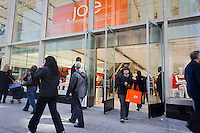Customers at the grand opening of the Joe Fresh store in the Midtown in New York on Friday, March 30, 2012. The Canadian retailer, founded by Joseph Mimran, (founder of Club Monaco), sells moderately and inexpensively priced apparel and was originally an exclusive product in the Canadian grocery chain, Loblaw's. The store is located in the former Manufacturers Hanover Trust Company landmark building built in 1954 and designed by Skidmore, Owings & Merrill's Gordon Bunshaft. (© Richard B. Levine)