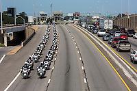 APD motorcade funeral procession of motorcycles travels south on Interstate 35 through downtown for Austin police officer Amir Abdul-Khaliq on Thursday September 8, 2016 - Stock Image.