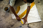 A master craftsman colours a woman's top at a batik workshop in Jaipur, Rajasthan, India.