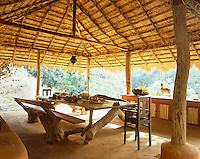 Robinson Crusoe-style, the furniture in the dining pavilion is made from planks of satinwood and gnarled old tree trunks