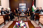 Palestinian President, Mahmoud Abbas meets with the British consul Alastair McPhail in the West bank city of Ramallah on December 24, 2016. Photo by Osama Falah