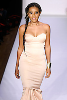 Angela Simmons walks the runway in an outfit by Samantha Black, from the Samantha Black Spring Summer 2012 collection, during Style 360 Fashion Week Spring 2012.