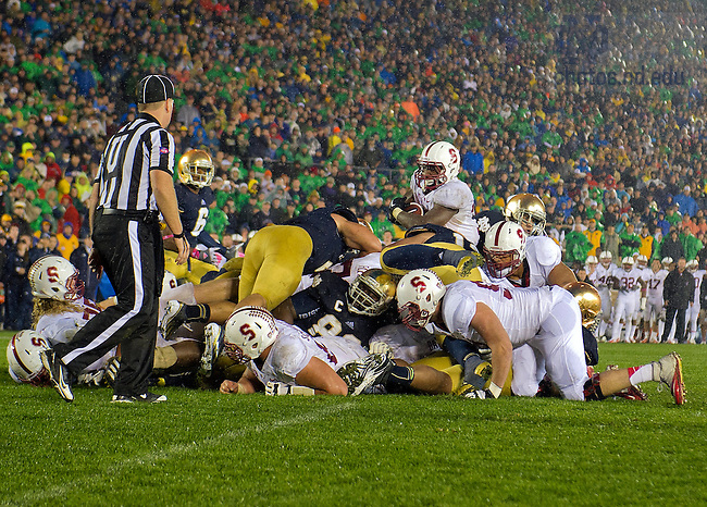 Oct. 13, 2012; Stanford running back Stepfan Taylor attempts to dive across the end zone as linebacker Manti Te'o (5) defends during overtime.  Photo by Barbara Johnston/University of Notre Dame