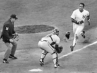 Yankees Dave Windfield coming down the line against catcher Ozzie Virgil Jr. who tagged him out. Umpire Don Denkinger..(1987 All-Star game in Oakland.)<br />photo/Ron Riesterer.