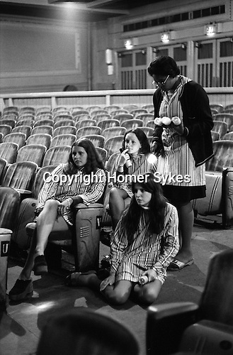 """Wings Tour 1975, Liverpool rehearsal,  usherettes listen a sound check. The photographs from this set were taken in 1975. I was on tour with them for a children's """"Fact Book"""". This book was called, The Facts about a Pop Group Featuring Wings. Introduced by Paul McCartney, published by G.Whizzard. They had recently recorded albums, Wildlife, Red Rose Speedway, Band on the Run and Venus and Mars. I believe it was the English leg of Wings Over the World tour. But as I recall they were promoting,  Band on the Run and Venus and Mars in particular."""