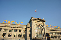 Pacific Central train and bus station, Vancouver, BC, Canada. This heritage building is also known as the Canadian Northern Railway Station.This Neoclassical Revival building is the built on reclaimed land that was part of False Creek. It continues to function as a train station but in 1993 the station became a multi transportation station where intercity buses also depart from. The heritage designation includes the neon sign.