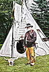 A mountainman furtrader in front of a tipi HDR