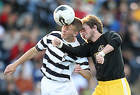 Creighton Preparatory's Mark Moulton, Jr. (left) and Grand Island's Quin Stolz (right) go for the ball during the first half of the Class A Boys State Soccer Championship final at Creighton University in Omaha on Monday. (Independent/Crystal LoGiudice)..