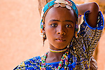 Dressed in her brightest, finest clothing, made-up, and wearing the hallmark silver coin jewelry of the Fulani of Niger, 9-year old Dicko readies herself to walk the five or so miles from her village to the town of Torodi. In Torodi, she will sell the fruit of the karey tree that she worked so hard to gather the past week.