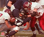 ANSONIA, CT 11/27/98 --1127JH10.tif--Ansonia's number 44 Tobias Freeman is grabbed by Naugatuck defenders during Friday's game in Ansonia. JOHN HARVEY staff photo for ? story.