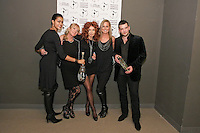 (l-r) Carmen Operetta, Kristina Cogswell, Fashion designer Eva Minge, and guests pose backstage, after the Eva Minge - DNA Minge range Fall/Winter 2011/2012 collection runway show, during New York Fashion Week Fall 2011.