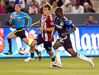Chivas USA forward Justin Braun (17) attempts to move past San Jose Earthquakes defender Ike Opara (6). CD Chivas USA defeated the San Jose Earthquakes 3-2 at Home Depot Center stadium in Carson, California on Saturday April 24, 2010.  .