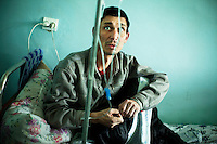 A tuberculosis (TB) patient, a former detainee of Specialised Prison Colony 27, receives his daily treatment at a TB rehabilitation centre where he can complete his treatment before returning to his family. Kyrgyzstan's prisons are experiencing a TB epidemic, where the incidence rate is estimated at 25 times higher than in civil society.