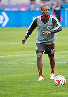 Toronto, Ontario - May 3, 2014: Toronto FC forward Jermain Defoe #18 in action during the warm-up in a game between the New England Revolution and Toronto FC at BMO Field.<br /> The New England Revolution won 2-1.