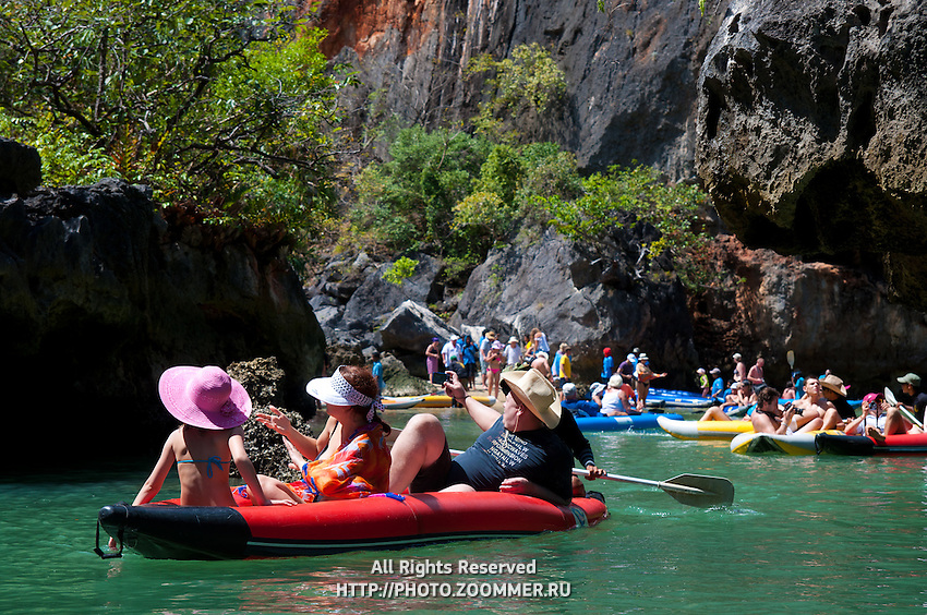 Tourists canoeing and kayaking in the national marine park of Phang Nga Bay, Thailand