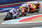Yamaha Factory rider Jorge Lorenzo leads Repsol Honda riders Dani Pedrosa and Casey Stoner through turn eleven during the U.S. MotoGP race at Mazda Raceway Laguna Seca, Sunday, July 29, 2012.