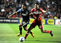 Chicago Fire defender Wilman Conde (22) pushes San Jose forward Arturo Alvarez (10) off the ball during the second half of a match between the San Jose Earthquakes and the Chicago Fire at Toyota Park in Bridgeview, IL on April 10, 2010.  San Jose Earthquakes 2, Chicago Fire 1.