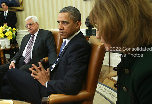 United States President Barack Obama (R) listens to an interpreter as he meets with Palestinian President Mahmoud Abbas (L) in the Oval Office of the White House March 17, 2014 in Washington, DC. President Obama met with President Abbas to discuss the progress in the Israeli-Palestinian negotiations and the establishment of a Palestinian state.  <br /> Credit: Alex Wong / Pool via CNP