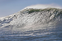 Surfer riding wave, Mavericks, Monterey Bay, California