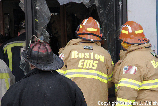 Fire in a block of stores at 126 Harvard Street Boston, MA. 4 alarms plus 2 extra ladder companies.