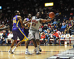 "Ole Miss' Reginald Buckner (23) grabs the ball against LSU's Storm Warren (24) and LSU's Malcolm White (5) at the C.M. ""Tad"" Smith Coliseum in Oxford, Miss. on Saturday, February 25, 2012. (AP Photo/Oxford Eagle, Bruce Newman).."