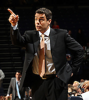 Dec. 22, 2010; Charlottesville, VA, USA; Virginia Cavaliers head coach Tony Bennett points at the shot clock during the game against the Seattle Redhawks at the John Paul Jones Arena. Seattle Redhawks won 59-53. Mandatory Credit: Andrew Shurtleff