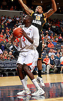 CHARLOTTESVILLE, VA- DECEMBER 6: Assane Sene #5 of the Virginia Cavaliers shoots in front of Sherrod Wright #10 of the George Mason Patriots during the game on December 6, 2011 at the John Paul Jones Arena in Charlottesville, Virginia. Virginia defeated George Mason 68-48. (Photo by Andrew Shurtleff/Getty Images) *** Local Caption *** Assane Sene;Sherrod Wright