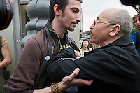 Moscow, Russia, 19/05/2012..An opposition activist [right] scuffles with a Russian Orthodox supporter, one of a small group that attempted to cause disruption as several thousand artists and opposition activists demonstrate against Vladimir Putin by walking through Moscow transporting their artworks. The protest coincided with Museum Night, when Moscow's museums are open until midnight with special exhibitions and performances.